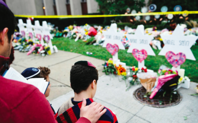 Praying at a memorial outside of the synagogue in Pittsburgh where 11 congregants were murdered. Brendan Smialowski/AFP/Getty Images