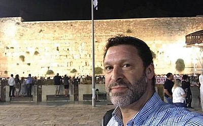 Ari Fuld, shown at the Western Wall in Jerusalem, worked at a nonprofit that provides food and supplies to Israeli soldiers. JTA