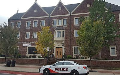 A Rutgers University police car is parked outside Rutgers Chabad on College Avenue, New Brunswick.