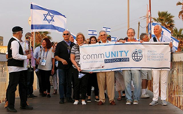 The trip began with a parade led by participants who, like Israel, turned 70 in 2018.