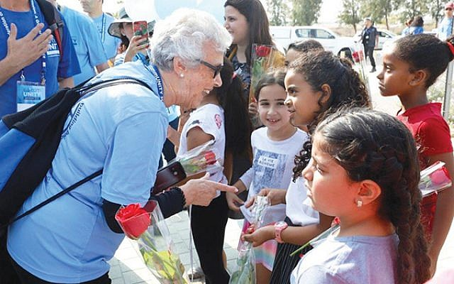 Barbara Drench is greeted by children from the partnership community of Ofakim; mission members traveled to Ofakim via the first non-stop train from Jerusalem.