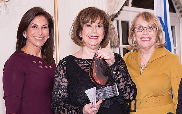Former Women's Division director Debbie Schwartz, center, receives her Diamond Gala award from Debbie Janoff, at left, and Sharon Halpern. Photos by Robert Schneider/Israel Bonds
