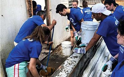 GOA students assisted members of Nechama, a Jewish disaster-relief organization, with debris removal and demolition of a home in San Juan.