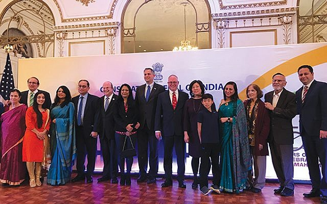 Rabbi David Levy, seventh from right, next to Israel's Deputy Consul General Israel Nitzan, at the Chanukah celebration with India's Consul General Sandeep Chakravorty, fifth from left, and other guests.