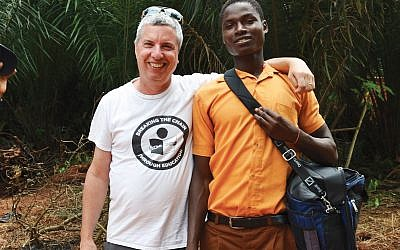 Evan Robbins, left, in Ghana with one of the formerly trafficked children he helped rescue. Photo courtesy of Evan Robbins