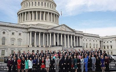 New House members, posing last week at the Capitol, are younger and more diverse than previous congressional classes. Israel could be in the crosshairs. GETTY IMAGES