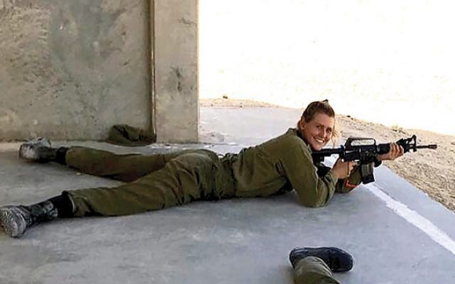 Arms and the woman: The author during M16 rifle training in the Negev. Photo courtesy Lilli Gottesman