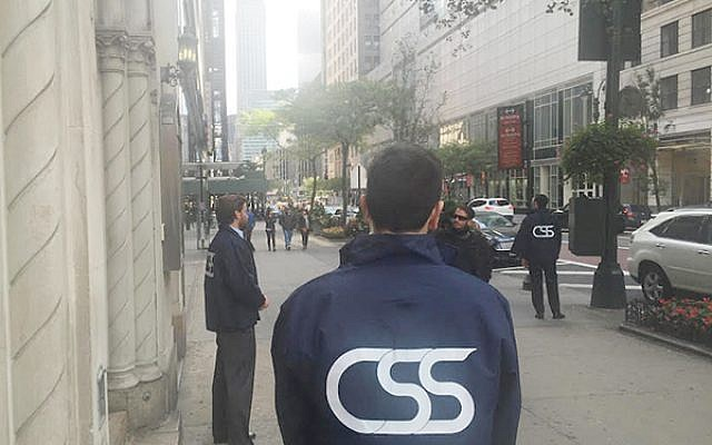 Sign of the times: Members of the Community Security Service force outside a synagogue. Courtesy of CSS