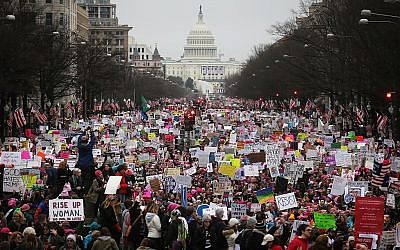 Protesters walk up Pennsylvania Avenue during the Women's March on Washington, with the U.S. Capitol in the background, on January 21, 2017 in Washington, DC. Getty Images