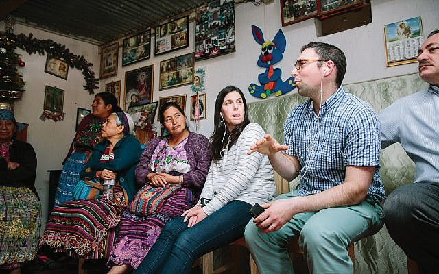 Rabbi Adam Baldachin, second from right, visits home of an indigenous midwife in Quetzaltenango, Guatemala. The collective she belongs to gets funding from AJWS. Courtesy of AJWS