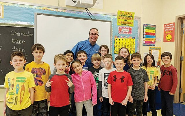 Dr. Scott Gersch with students at a Union County elementary school.