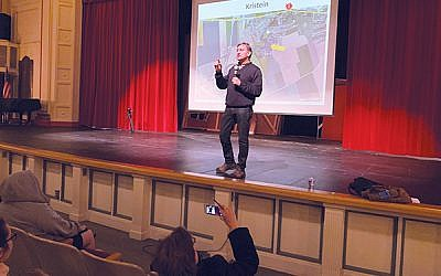 Jack Hersch talks about his father's life and his experiences retracing it at a presentation in Morristown High School. Photo by Johanna Ginsberg