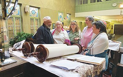 An emotional Daviyd Hawkins, at left, is comforted by fellow b'nei mitzvah celebrants Linda Bloom, Alla Eicheldinger, Joan Podnos, and Flora Sonners. Photo by Johanna Ginsberg