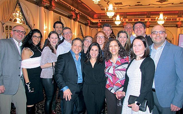 A group from Morristown's Temple B'nai Or, Randi and David Silverstein's congregation, at the March fund-raiser. (Photo by Renee Glick)