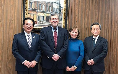 The author and his wife, Maris Chavenson, with Takanobu Fuchikami, mayor of the Japanese city of Tsuruga, at left, and Vice Mayor Fujio Katayama. (Photos by Martin Raffel)