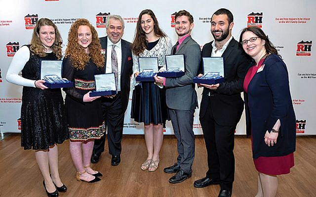 With Rutgers Hillel executive director Andrew Getraer, third from left, and associate senior executive director Rabbi Esther Reed, far right, are the student Rising Stars honored at the Rutgers Hillel gala, from left, Leora Hyman of Teaneck, Talia Schabes of Englewood, Elisheva Sherman of Highland Park, Zach Steinhardt of Morris Plains, and Segev Kanik of Deal. Photos by Mike Schwartz Photography