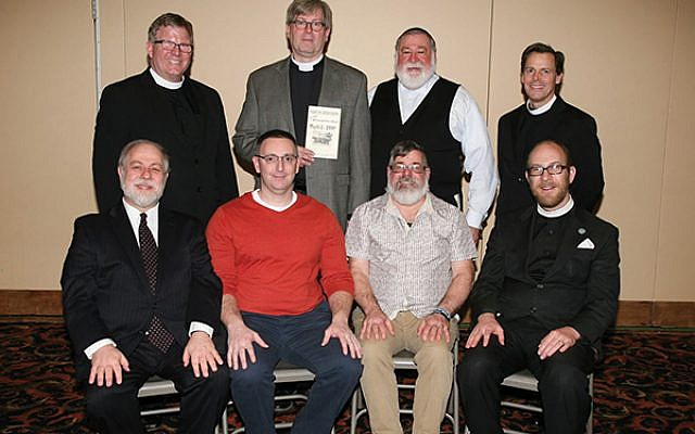 Reunion attendees included, back row, from left, Fr. Ed Zelly, Rev. Jeffrey Roy, Rabbi Nathan Langer, and Pastor Dean Brown; back row, Rabbi Robert Pilavin, Dan Rozett, Pastor Joe Gratzel, and Fr. John Mason Lock.