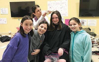 From left, Hannah Rosenfeld, Chloe Henslovitz, Elyse Commer, and Emunah Mischel each donated several inches of hair.