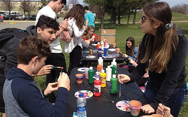 Teens painted flower pots to be donated to Holocaust survivors at Café Europa, a program of Jewish Family Service of Middlesex County.