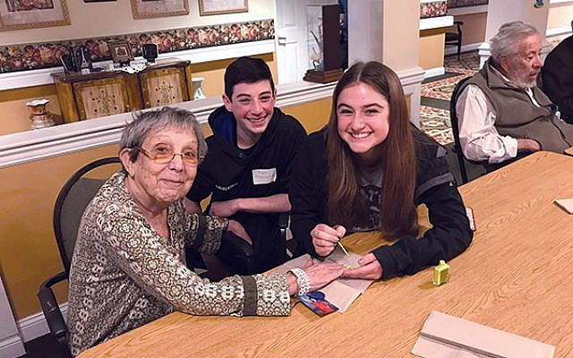 J-SERVE and CTeen of Western Monmouth County members gave manicures to residents of Mattison Crossing at Manalapan Avenue.