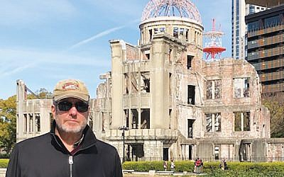 The author in front of the A-Bomb Dome in  Hiroshima. Photo Courtesy Martin Raffel