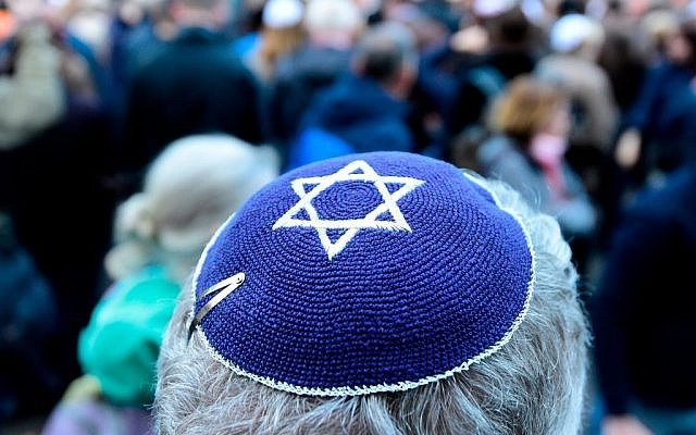 """A participant of the """"Berlin wears kippa"""" rally wears a kippa in Berlin on April 25, 2018. - Germans stage shows of solidarity with Jews after a spate of shocking anti-Semitic assaults, raising pointed questions about Berlin's ability to protect its burgeoning Jewish community seven decades after the Holocaust. Getty Images"""