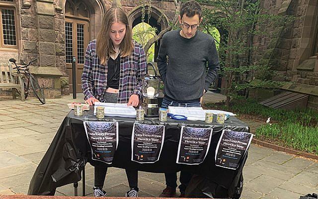 Princeton University's Katie Irelan and Jacob Brown read names of Shoah victims.