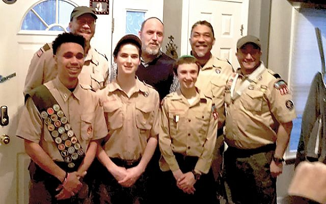 Scouts and leaders pose at Troop 365's recent Court of Honor. Front, from left, Jared Robertson, Ari Rogers, Michael Spool, and Aaron Spool. Back, from left, Joe Gill, Rabbi Robert Tobin, and Mark Robertson. Photos Courtesy Aaron Spool