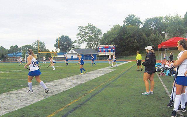 Samantha Berk, right, coaches her Cranford High School field hockey team during the 2019 season. Photos courtesy Samantha Berk
