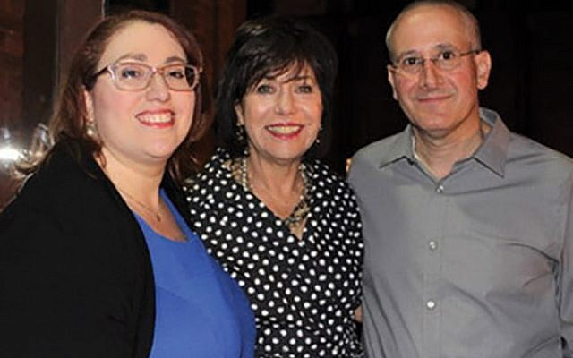 Leslie Sporn, center, with Cantor Rebecca Moses and Rabbi Daniel Cohen at the party celebrating her retirement.