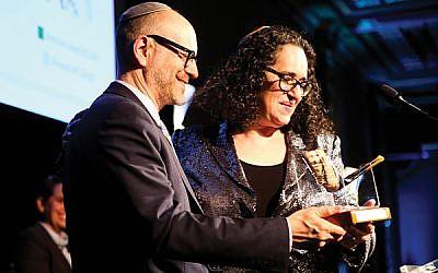 Rabbi Elliott Tepperman of Bnai Keshet receives the Human Rights Hero award from Rabbi Ayelet Cohen, a board member of T'ruah, at the organization's May 22 gala. Photo by Shulamit Seidler-Feller