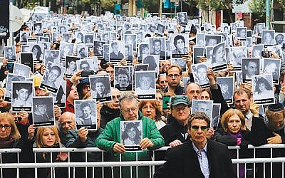 Family members of victims of the 1994 bombing of the Jewish community center in Buenos Aires mark the 25th anniversary of the July 18 attack. HUGO VILLALOBOS/AFP/Getty Images