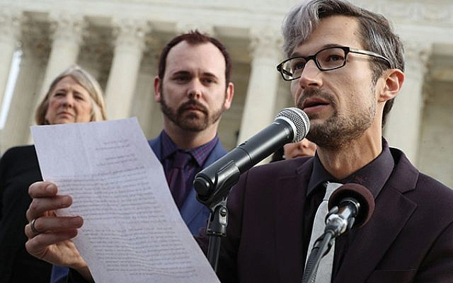 Charlie Craig, at microphone, and David Mullins sued a Colorado cake shop after its owner refused to design a cake for their same-sex marriage. The Supreme Court ruled narrowly in the baker's favor. Getty Images