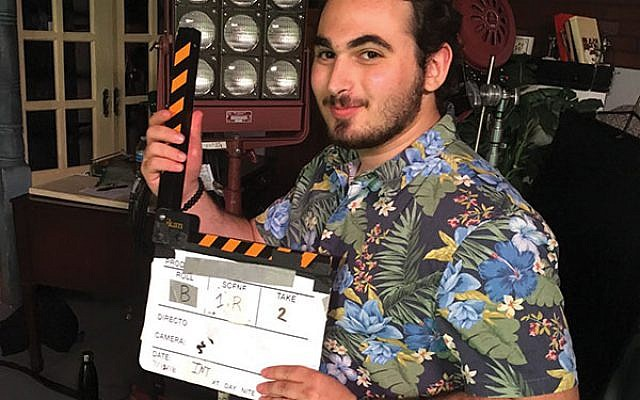 Matt Kamis of Berkeley Heights prepares to direct on a film set. He is producing a Jewish-themed short for his senior thesis. Photos courtesy Matt Kamis