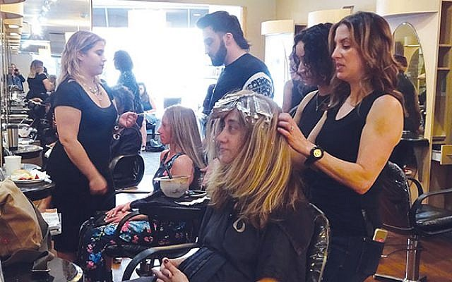 Ani Benilan, a client at the NCJW/Essex Center for Women, gets a new look from Anthony Garubo Salon hair stylist Ashley Garubo.