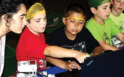 Campers working on computers during the 2018 pilot ORT Start-up Challenge, which has representatives visiting three NJY Camps this week. Photo courtesy ORT