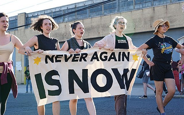 Members of the new activist group Never Again Action during a protest Sunday at an ICE facility in Elizabeth. Nur Shlapobersky
