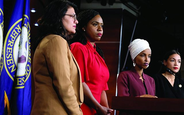 "Members of the ""Squad ""— Democratic Reps. Rashida Tlaib, left, Ayanna Pressley , Ilhan Omar and Alexandria Ocasio Cortez — at a press conference in July denouncing President Trump's tweets as racist. The president called out their anti-Israel positions. Getty Images"