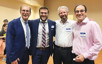 The Kulanu team, from left, Larry Rein, director Binyamim Bromberg, Ira Bloom, and Moshe Glick, all of West Orange, at the Aug. 7 open house. Photos by Johanna Ginsberg