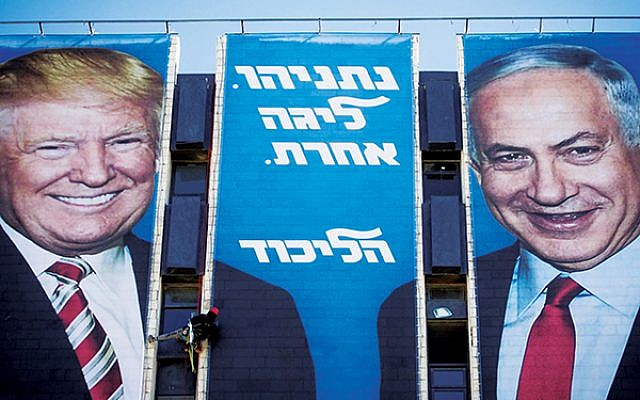 """Campaign billboards show President Trump and Prime Minister Netanyahu with the slogan """"Netanyahu — another league,"""" suggesting that only Bibi has the access to world leaders that will help keep Israelis safe. Getty Images"""