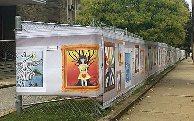 Teens' artwork, hung on a chain-link fence, rings Tree of Life synagogue. Photos by Beth Kissileff