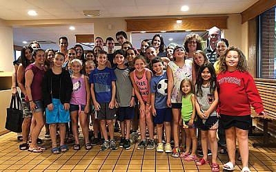 Rabbi Dina Rosenberg, second row, far right, with children and parents on a Temple Beth Shalom ice cream meet and greet.  Photos courtesy Rabbi Dina Rosenberg