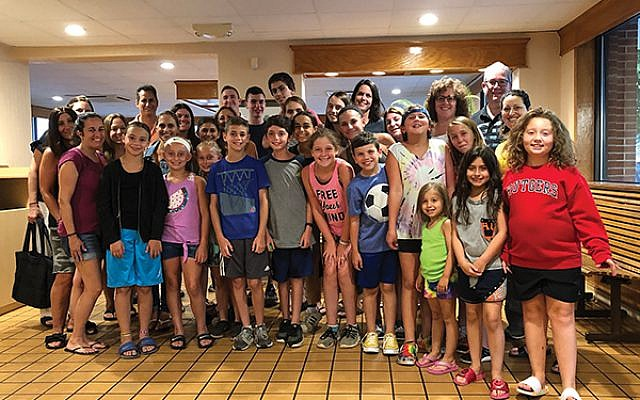 Rabbi Dina Rosenberg, second row, far right, with children and parents on a Temple Beth Shalom ice cream meet and greet.  Photos courtesy Rabbi Dina Rosenberg