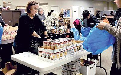 Marlboro Jewish Center congregants collect canned goods for a food drive. Courtesy Marlboro Jewish Center