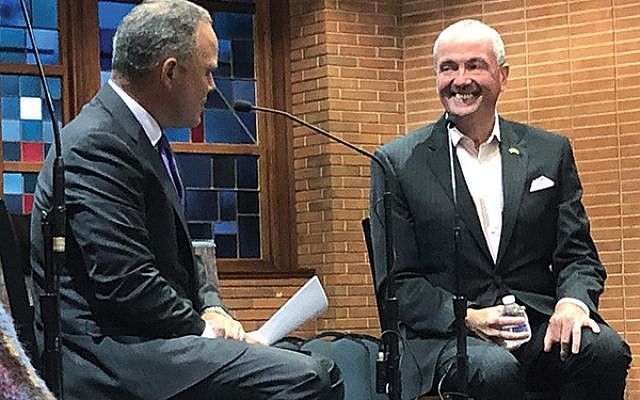 CBS national correspondent and reporter Jim Axelrod, a 20-year member of Temple Ner Tamid in Bloomfield, led the discussion with New Jersey Governor Phil Murphy on Sept. 9. Photos by Jed Weisberger