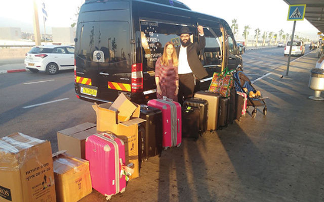 Under African skies: Rabbi Moishi and Yocheved Raskin on their way to a posting in Uganda. Photo Courtesy Chabad.org