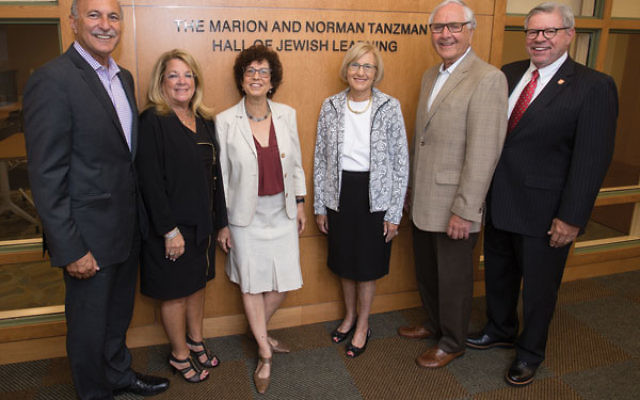 At the dedication ceremony of the Marion and Norman Tanzman Hall of Jewish Learning are, from left, Roy Tanzman and Brenda Tanzman, Bildner executive director Yael Zerubavel, Rona and Jeffries Shein, and Rutgers University chancellor Richard Edwards.