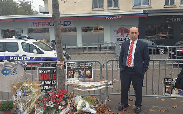 ADL CEO Jonathan Greenblatt at the memorial outside the Hyper Cacher kosher market in Paris, where terrorists murdered four Jewish patrons, and held 15 others hostage in a Jan. 9, 2015, attack    Photo courtesy Anti-Defamation League