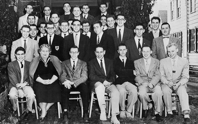 Members of Rho Epsilon, the Rutgers affiliate of Alpha Epsilon Pi, in 1957, together with their housemother.