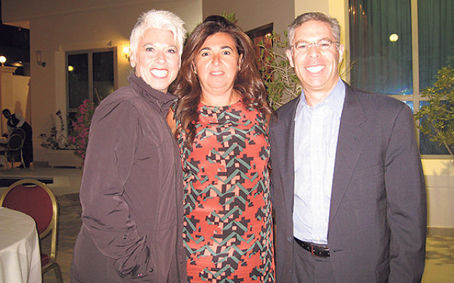 Michael and Lori Feldstein with Houda Nonoo, center, the Jewish woman who served as ambassador from Bahrain to the United States.
